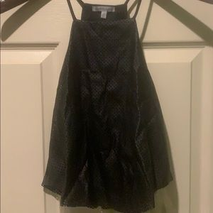 Cropped halter top. Pleather perforated